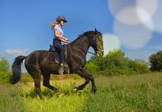 Young riding girl stock image