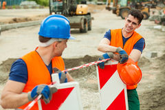 Young road construction workers Royalty Free Stock Photo