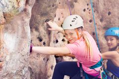 Young rock climber in helmet training outdoors Royalty Free Stock Photo