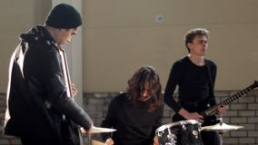 A young rock group getting ready for repetition. Mid shot