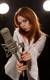 Young rock and roll singer with microphone Royalty Free Stock Images