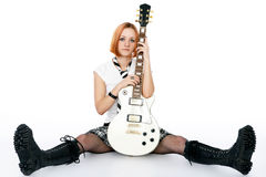 Young rock star with a guitar royalty free stock image