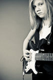 Girl with guitar Stock Photography