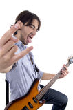 Young rock star posing with guitar. Isolated on white background Stock Photo