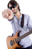 Young rock star posing with guitar. On an isolated white background Stock Photography