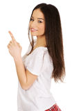 Young rock woman pointing up. Royalty Free Stock Photo