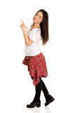 Young rock woman pointing up. Royalty Free Stock Photography