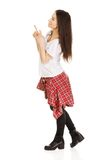 Young rock woman pointing up. Stock Photos