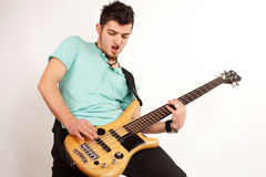 Young rocker with bass player with turquoise t shirt Stock Photography