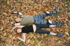 Young roller couple lies Royalty Free Stock Images