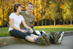 Young roller couple sit Stock Photo