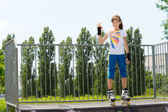 Young roller skater giving a Perfect gesture Royalty Free Stock Image