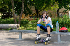 Young roller skater taking a rest Stock Photos