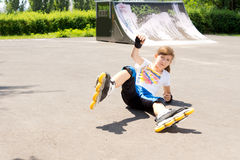 Young rollerblader takes a tumble Royalty Free Stock Photo