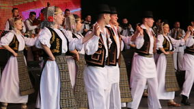 Young Romanian dancers in traditional costume stock video