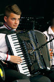Young Romanian folk artist on the accordion Stock Photo