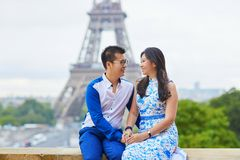 Young romantic Asian couple in Paris. Young romantic Asian couple embracing in front of Eiffel Tower, Paris, France Royalty Free Stock Image