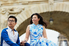 Young romantic Asian couple in Paris, France. Young romantic Asian couple having a date on the bridge over the Seine near the Eiffel Tower, Paris, France Royalty Free Stock Photo