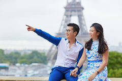 Young romantic Asian couple in Paris, France. Young romantic Asian couple on Trocadero view point near the Eiffel tower in Paris, France Royalty Free Stock Image
