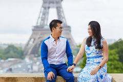 Young romantic Asian couple in Paris, France. Young romantic Asian couple on Trocadero view point near the Eiffel tower in Paris, France Royalty Free Stock Photos