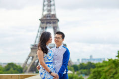 Young romantic Asian couple in Paris, France. Young romantic Asian couple on Trocadero view point near the Eiffel tower in Paris, France royalty free stock photography