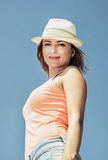 Young romantic brunette woman posing in outdoor with sunhat Royalty Free Stock Photography