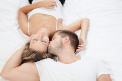 Young romantic couple in bed Stock Image