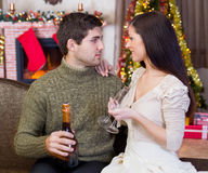 Young romantic couple celebrate Christmas night. Couple holding glasses with champagne and celebrate Christmas night royalty free stock image