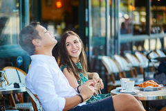 Young romantic couple in a cozy outdoor cafe in Paris, France Royalty Free Stock Image