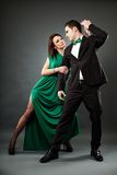 Young romantic couple dancing tango Stock Images