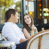 Young romantic couple drinking coffee in Paris, France Royalty Free Stock Image