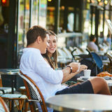 Young romantic couple drinking coffee in Paris, France Royalty Free Stock Photo