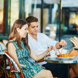 Young romantic couple drinking coffee in Paris, France Stock Photos