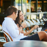 Young romantic couple drinking coffee in Paris, France Royalty Free Stock Photography