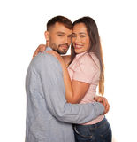 Young romantic couple embraced looking at camera Stock Images