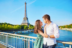 Young romantic couple having a date near the Eiffel tower Stock Images