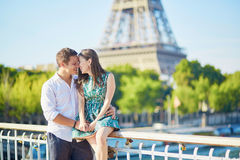 Young romantic couple having a date near the Eiffel tower Stock Photo
