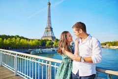 Young romantic couple having a date near the Eiffel tower Stock Photography