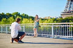 Young romantic couple having a date near the Eiffel tower Royalty Free Stock Images