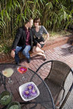 Young romantic couple having drinks on patio Stock Image