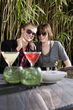 Young romantic couple having drinks on patio Royalty Free Stock Image