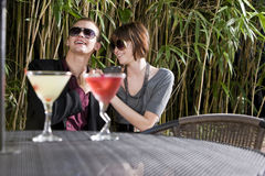 Young romantic couple having drinks on patio Royalty Free Stock Images