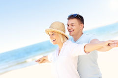 Young romantic couple hugging at the beach Royalty Free Stock Photo