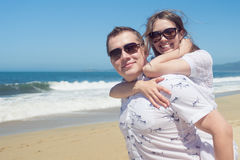 Young romantic couple hugging on the beach Stock Image
