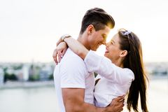Young beautiful couple hugging and about to kiss Stock Image