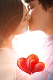 Young romantic couple kissing. In love with sun light Royalty Free Stock Image