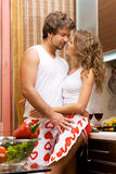 Young romantic couple in the kitchen Stock Image
