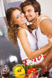 Young romantic couple in the kitchen Royalty Free Stock Images