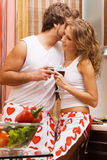 Young romantic couple in the kitchen Stock Photos