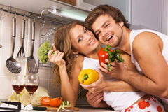Young romantic couple in the kitchen Stock Photography